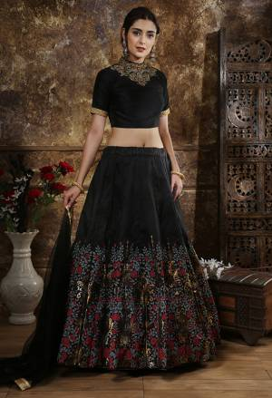 For A Bold And Beautiful Look, Grab This Deisgner And Elegant Looking Lehenga Choli In All Over Black Color. This Lehenga Choli Is Silk Based Paired With Net Fabricated Dupattta. Its Lehenga Is Beautified With Attractive Foil Print And Embroidery Over The Blouse.