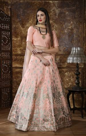 This Season About Subtle Shades And Pastel Play, So Grab Very Pretty Designer Lehenga Choli In Pastel Peach Color. This Lehenga Choli Is Fabricated On Art Silk Paired With Net Fabricated Dupatta. It Is Beautified With Foil Print And Embroidery.