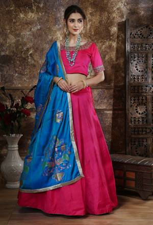 Shine Bright Wearing This Designer Lehenga Choli In Rani Pink Color Paired With Blue Colored Dupatta. This Lehenga And Choli Are Fabricated On Art Silk Paired With Soft Silk Fabricated Dupatta. Buy Now.