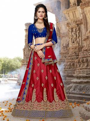 Grab This Attractive Looking Designer Lehenga Choli In Royal Blue Colored Blouse Paired With Contrasting Red Colored Colored Lehenga And Dupatta. Its Blouse And Lehenga Are Fabricated On Art Silk Paired With Net Fabricated Dupatta. It Is Beautified With Heavy Embroidery All Over.