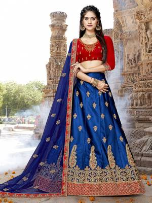 Shine Bright In This Designer And Attractive Looking Lehenga Choli In Red Colored Blouse Paired With Contrasting Royal Blue Colored Lehenga And Dupatta. Its Blouse And Lehenga Are Fabricated On Art Silk Paired With Net Fabricated Dupatta. Buy This Lehenga Choli Now.