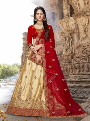 Evergreen Combination Is Here With This Heavy Designer Lehenga Choli In Red Colored Blouse Paired With Beige Colored lehenga And Red Colored Dupatta. This Silk Based Lehenga Choli Gives A Rich Look To Your Personality.
