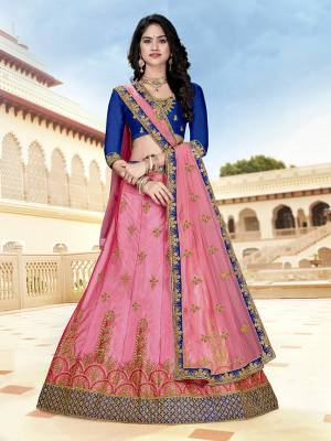 Look Pretty In This Heavy Designer Lehenga Choli In Royal Blue Color Paired With Contrasting Pink Colored Lehenga And Dupatta. Its Blouse And Lehenga Are Fabricated On Art Silk Paired With Net fabricated Dupatta. Buy Now.