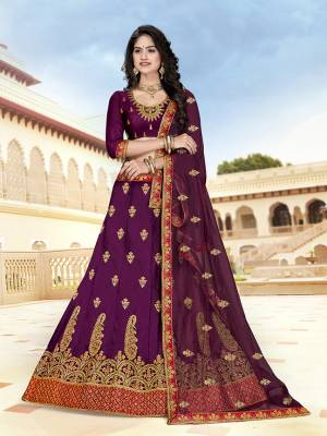 Attract All Wearing This Heavy Designer Lehenga Choli In All Over Purple Color. This Lehenga Choli Is Art Silk Based Paired With Net Fabricated Dupatta. Buy Now.