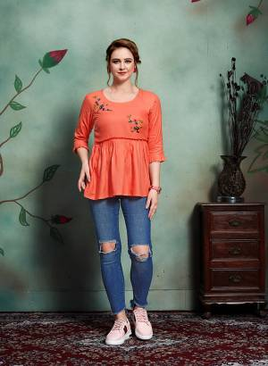 For Your College Wear Or Work Place, Grab This Designer Readymade Top In Orange Color Fabricated On Rayon Beautified With Contrasting Thread Work. It Is Availble In all Regular Sizes. Buy Now.