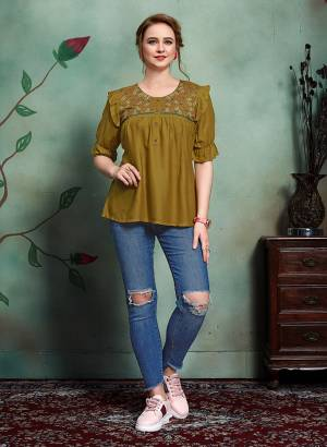 New Shade In Top Is Here With This Designer Readymade Top In Olive Green Color Fabricated On Rayon. It Is Beautified With Few patterns and Thred Work.