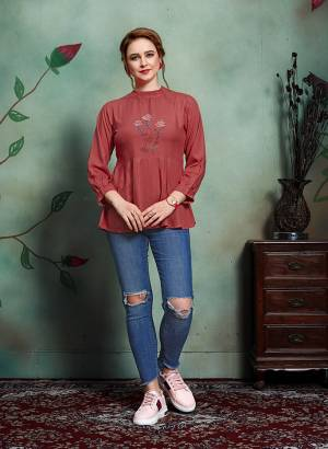 Grab This Pretty Designer Readymade Top In Maroon Color Fabricated On Rayon. It Has Elegant High Neck Pattern Beautified With Thread Work.