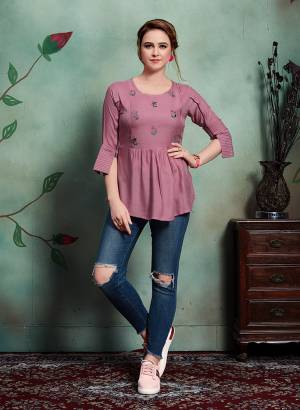 Add This very Pretty Readymade Top In Onion Pink Color Fabricated On Rayon. Its pretty Color And Minimal Embroidery Will Earn You Lots Of Compliments From Onlookers.