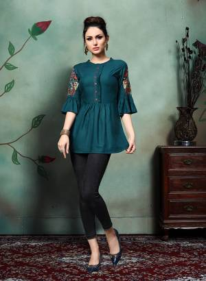 Enhance Your Personality Wearing This Designer Readymade Top In Teal Blue Color Fabricated On Rayon. This Pretty Top Is Beautified With Contrasting Colored Thread Work Over The Sleeves. Buy Now.