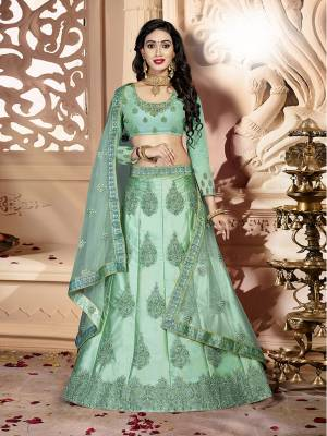 Grab This Rich And Elegant Looking Heavy Designer Lehenga Choli In Mint Green Color. Its Blouse Is fabricated On art Silk Paired With Satin Silk Lehenga And Net Fabricated Dupatta. It Is Beautified With Heavy Jari And Resham Embroidery With Stone Work. Buy This Pretty Piece Now.