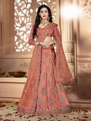 Grab This Rich And Elegant Looking Heavy Designer Lehenga Choli In Rust Orange Color. Its Blouse Is fabricated On art Silk Paired With Satin Silk Lehenga And Net Fabricated Dupatta. It Is Beautified With Heavy Jari And Resham Embroidery With Stone Work. Buy This Pretty Piece Now.