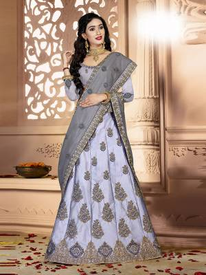 Grab This Rich And Elegant Looking Heavy Designer Lehenga Choli In Grey Color. Its Blouse Is fabricated On art Silk Paired With Satin Silk Lehenga And Net Fabricated Dupatta. It Is Beautified With Heavy Jari And Resham Embroidery With Stone Work. Buy This Pretty Piece Now.