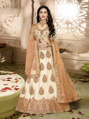 Grab This Rich And Elegant Looking Heavy Designer Lehenga Choli In Peach Color. Its Blouse Is fabricated On art Silk Paired With Satin Silk Lehenga And Net Fabricated Dupatta. It Is Beautified With Heavy Jari And Resham Embroidery With Stone Work. Buy This Pretty Piece Now.