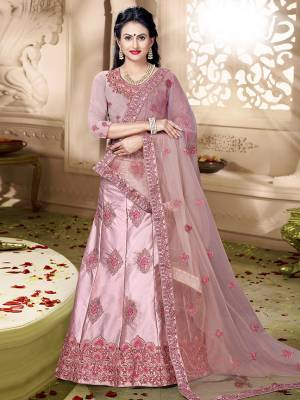 Grab This Rich And Elegant Looking Heavy Designer Lehenga Choli In Dusty Pink Color. Its Blouse Is fabricated On art Silk Paired With Satin Silk Lehenga And Net Fabricated Dupatta. It Is Beautified With Heavy Jari And Resham Embroidery With Stone Work. Buy This Pretty Piece Now.