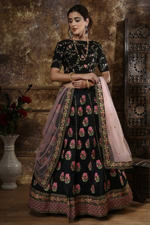 Get Ready For This Wedding Season And Be The Most Sensational Diva Wearing This Bold and Stylish Heavy Designer Lehenga Choli In Black Color Paired With Baby Pink Colored Dupatta. This Heavy Embroidered Lehenga Choli Is Fabricated On Art Silk Paired With Net Fabricated Dupatta. It Is Beautified With Contrasting Embroidery Over The Blouse And Lehenga.