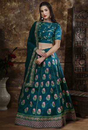Add This Pretty Shade To Your Wardrobe With This Heavy designer Lehenga Choli In All Over Teal Blue Color. This Embroidered Lehenga And Choli are Fabricated On Art Silk Paired With Georgette Fabricated Dupatta.