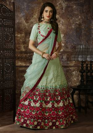This Season Is About Subtle Shades And Pastel Play, So Grab This Very Pretty Designer Lehenga Choli In Pastel Green Color Which Is Beautified With Contrasting Colored Embroidery. Its Blouse And Lehenga Are Fabricated On Art Silk Paired With Net Fabricated Dupatta. Buy Now.