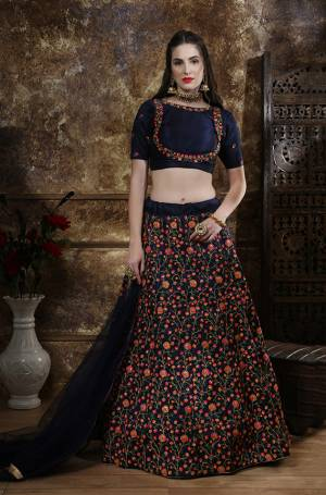 Enhance Your Personality Wearing This Attractive And Heavy Embroidered Designer Lehenga Choli In Navy Blue Color. This Lehenga Choli Is Fabricated On Art Silk Paired With Net Fabricated Dupatta. Buy This Bold And Stylish Lehenga Choli Now.
