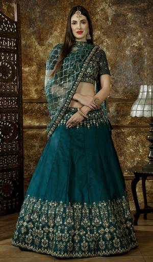 New Shade Is Here Add Into Your Wardrobe With This Heavy Designer Lehenga Choli In Teal Green Color. This Pretty Heavy Embroidered Lehenga Choli Is Fabricated On Satin Silk Paired With Net Fabricated Dupatta. Buy Now.