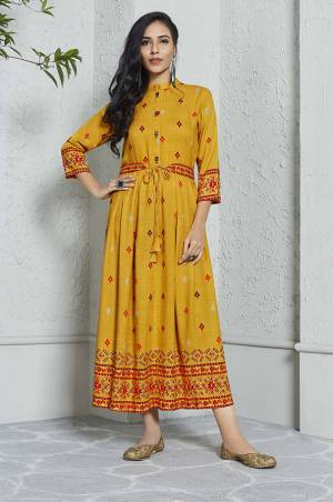 Celebrate This Festive Season With Beauty And Comfort Wearing This Designer Readymade Kurti In Musturd Yellow Color Fabricated On Rayon. This Pretty Kurti Is Beautified With Prints And Available In All Sizes.