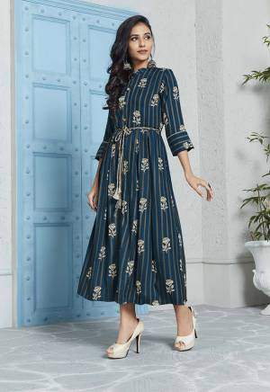 For Your Semi-Casuals, Grab This Designer Readymade Kurti In Navy Blue And Grey Color Fabricated On Rayon. It Is Beautified With Prints All Over. Its Rich Color And Elegant Pattern Will earn You Lots Of Compliments From Onlookers.