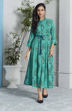 Grab This Pretty Readymade Kurti In Turuqoise Blue Color Fabricated On Rayon. This Kurti Is Beautified With Simple Prints And It Is Available In All Sizes.