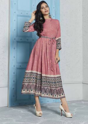 Look Beautiful Wearing This Designer Readymade Kurti In Dusty Pink Color Fabricated on Rayon. This Pretty Kurti Is In Calf Length So You can Wear It As It Is And Also You Can Pair It Up Leggings.
