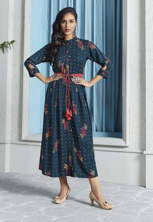 New Shade In Blue Is Here With This Designer Readymade Calf Length Kurti In Prussian Blue Color Fabricated On Rayon. This Kurti Is Beautified With Pretty Prints Giving It An Attractive Look.
