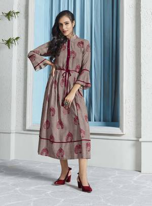 Flaunt Your Rich And Elegant Taste In This Designer Readymade Kurti In Grey Color Fabricated On Rayon. This Kurti Is Beautified With Pretty Motif Prints All Over It.