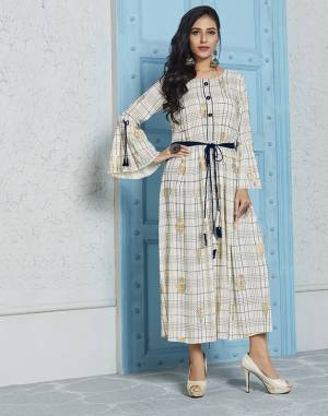 Simple And Elegant Looking Designer Readymade Kurti Is Here In Off-White Color. This Pretty Checks Printed Kurti Is Fabricated On Rayon With Foil Printed Motifs.