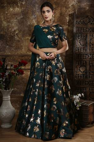 New Shade Is Here Add Into Your Wardrobe With This Designer Lehenga Choli In Teal Green Color Paired With Teal Green Colored Attached Dupatta. This Lehenga And Choli Are Fabricated On Satin Silk Paired With Georgette Fabricated Dupatta. This Attractive Looking Blouse And Lehenga Are BEautified With Foil Prints All Over.