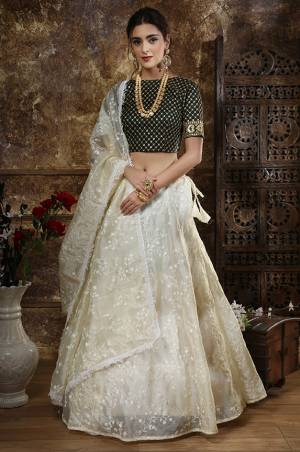 Flaunt Your Rich And Elegant Taste Wearing This Designer Lehenga Choli In Black Colored Blouse Paired With Off-White Colored lehenga And Dupatta. Its Pretty Embroidered Blouse Is Fabricated On Satin Silk Paired With Orgenza Fabricated Lehenga And Dupatta Beautified With Tone To Tone Embroidery.