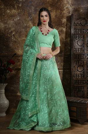 Get Ready For The Upcoming Festive And Wedding Season With This Heavy Designer Lehenga Choli In All Over Green Color. Its Blouse Is Fabricated On Art Silk Paired With Orgenza Fabricated Lehenga And Dupatta. It Is Beautified With Tone To Tone Embroidery All Over.