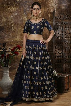 Enhance Your Personality Wearing This Heavy Designer Lehenga Choli In All Over Navy Blue Color. This Rich Embroidered Lehenga Choli Is Silk Based Paired With Net Fabricated Dupatta. It Is Durable And Easy Carry Throughout The Gala.