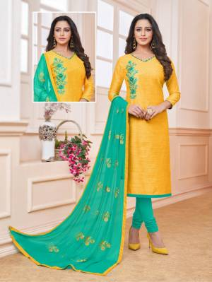 Celebrate This Festive Season With Beauty And Comfort Wearing This Designer Straight Suit In Yellow Color Paired With Contrasting Sea Green Colored Bottom And Dupatta. Its Top Is Fabricated On Art Silk Paired With Cotton Bottom And Chiffon Dupatta.