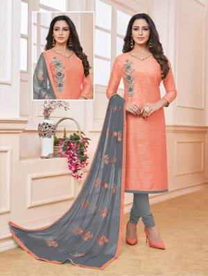 Celebrate This Festive Season With Beauty And Comfort Wearing This Designer Straight Suit In Peach Color Paired With Contrasting Grey Colored Bottom And Dupatta. Its Top Is Fabricated On Art Silk Paired With Cotton Bottom And Chiffon Dupatta.