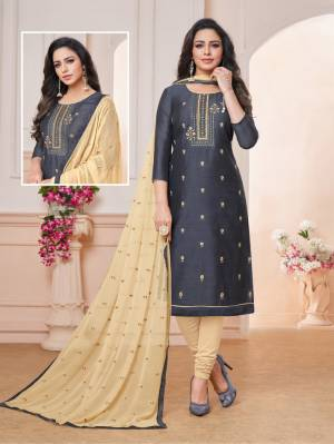 Grab This Pretty Dress Material For Your Semi-Casuals In Dark Grey Colored Top paired With Cream Colored Bottom And Dupatta. Its Embroidered Top Is Fabricated On Art Silk Paired With Cotton Bottom And Chiffon Fabricated Embroidered Dupatta. Buy Now