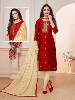 Grab This Pretty Dress Material For Your Semi-Casuals In Maroon Colored Top paired With Cream Colored Bottom And Dupatta. Its Embroidered Top Is Fabricated On Art Silk Paired With Cotton Bottom And Chiffon Fabricated Embroidered Dupatta. Buy Now