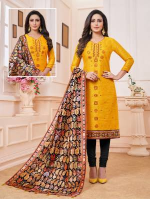 Here Is A Dress Material In Musturd Yellow And Black Color. Its Top Is Fabricated on Art Silk Paired With Cotton Bottom And Soft Silk Fabricated Digital Printed Dupatta. Get This Stitched As Per Your Desired Fit And Comfort.