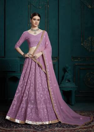 Very Pretty And Trending Shade In Purple Is Here With This Heavy Designer Lehenga Choli In Lavendor Color. This Pretty Lehenga Choli Is Georgette Based Beautified with Subtle Tone To Tone Embroidery. Its Pretty Color And Elegant Embroidery Will Rarn You Lots Of Compliments From Onlookers.