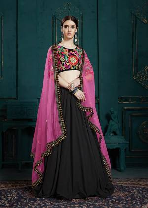 Go Colorful With This Designer Lehenga Choli In Multi Colored Blouse Paired With Black Colored Lehenga And Dark Pink Colored Dupatta. Its Blouse And Lehenga Are Fabricated On Georgette Paired With Net Fabricated Dupatta.
