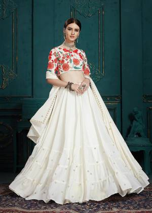 Simple And Elegant Looking Designer Lehenga Choli Is Here In All Over White Color. This Pretty Lehenga Choli Is Georgette Based. Its Pretty Blouse Is Beautified With Multi Colored Embroidery Giving It An Attractive Look.