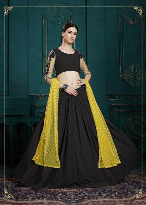 For A Bold And Beautiful Look, Grab This Designer Lehenga Choli In Black Color Paired With Yellow Colored Dupatta. Its Blouse And Lehenga Are Georgette Based Paired With Net Fabricated Dupatta. Buy This Now.