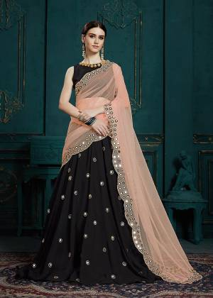 You Will Definitely Earn Lots Of Compliments Wearing This Designer Lehenga Choli In Black Color Paired With Peach Colored Dupatta. It Is Beautified With Attractive Mirror Work And Cutwork Dupatta. Its Lovely Color Pallete And Embroidery Give You A Look Like Never Before.