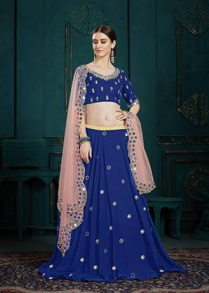 You Will Definitely Earn Lots Of Compliments Wearing This Designer Lehenga Choli In Royal Blue Color Paired Contrasting Baby Pink Colored Dupatta. It Is Beautified With Attractive Mirror Work And Cutwork Dupatta. Its Lovely Color Pallete And Embroidery Give You A Look Like Never Before.
