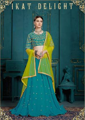 Catch All The Limelight At The Next Wedding You Attend Wearing This Designer Lehenga Choli In Blue Color Paired With Contrasting Yellow Colored Dupatta. This Lehenga Choli Is Fabricated On Georgette Paired With Net Fabricated Dupatta. Buy Now.