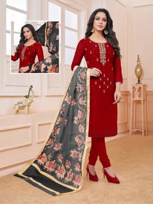 Enhance Your Personality Wearing This Designer Straight Suit In Maroon Color Paired With Contrasting Grey Colored Dupatta. Its Embroidered Top Is Fabricated On Modal Silk Paired With Cotton Bottom And Cotton Silk Fabricated Dupatta.