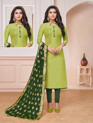 Look Pretty Wearing This Designer Straight Suit In Light Green Color Paired With Dark Green Colored Bottom And Dupatta. Its Top Is Fabricated On Modal Silk Paired With Cotton Bottom And Banarasi Art Silk Weaved Dupatta. Buy Now.