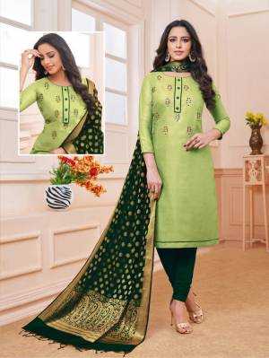 Flaunt Your Rich And Elegant Taste Wearing This Designer Straight Suit In Light Green Color Paired With Dark Green Colored Bottom And Dupatta. Its Top Is Fabricated On Linen Satin Paired With Cotton Bottom And Banarasi Art Silk Dupatta. Buy This Dress Material Now.