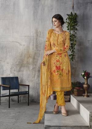 Look Pretty Wearing This Designer Suit In Musturd Yellow Color. Its Top Is Fabricated On Georgette Paired With Santoon Bottom And Chiffon Fabricated Dupatta. Its Top Is Beautified With Digital Prints And Lakhnavi Work. Buy Now.